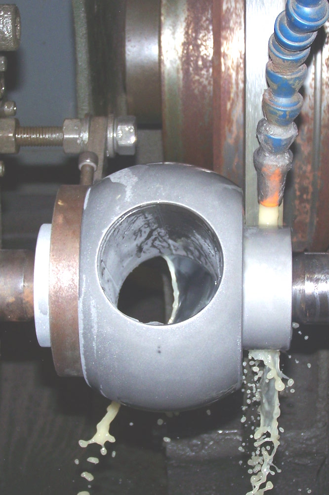 Ball valve wear resistant coating being ground for precision fit